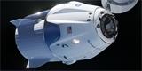 Sledovali jsme on-line, jak se Crew Dragon vrátil na Zemi. Pusťte si český záznam