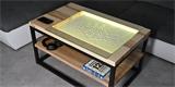 Nápad z české hlavy: chytrý stůl GlyGlo místo obrazovky kreslí do písku kovovou kuličkou